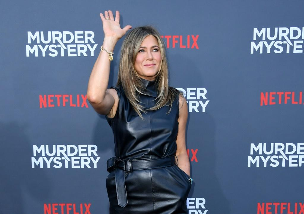 """Actress Jennifer Aniston arrives to attend the Los Angeles premiere screening of the Netflix film """"Murder Mystery"""" at the Regency Village Theatre in Los Angeles on June 10, 2019"""