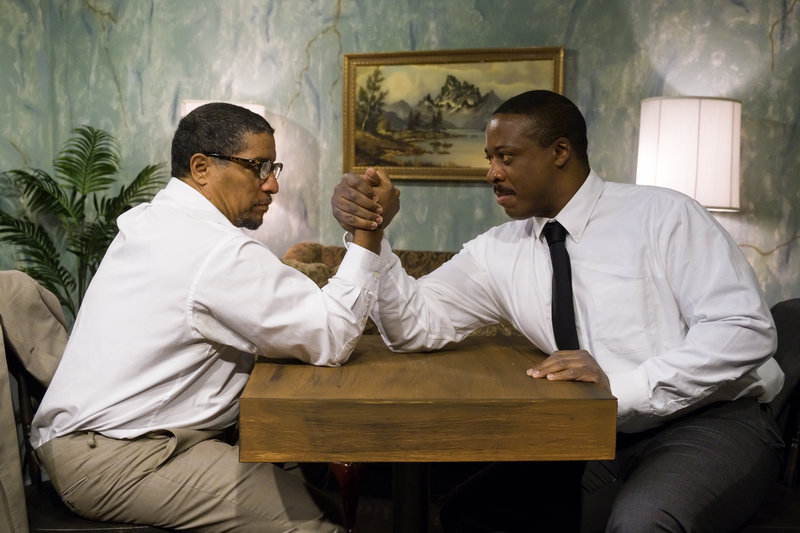 Malcolm X (Rhys Greene) and Dr. Martin Luther King Jr. ( J. Kay Weldon) arm wrestle to decide the way forward during Jeff Stetson's'The Meeting' presented by Point Loma Playhouse. PHOTO BY JOHN HOWARD
